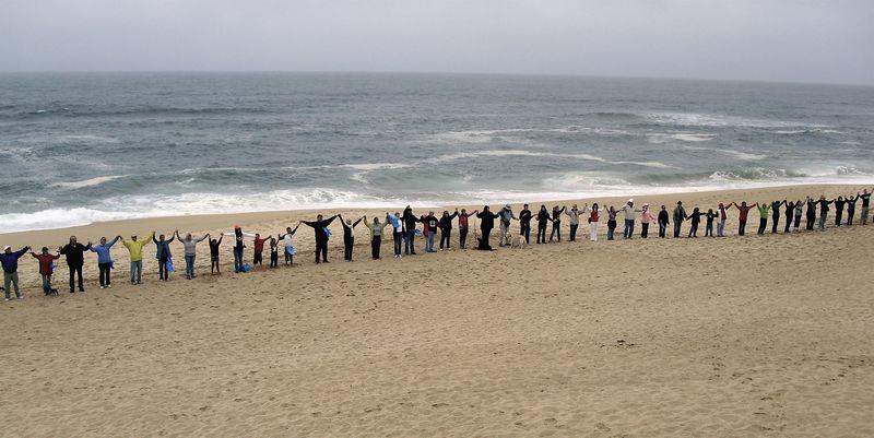 Hands across sand
