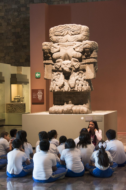 Mexico 07 Mexico City school group w statue of Coatlicue